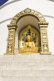 POKHARA, NEPAL, 20 MAY: Gold Buddha from the World Peace Pagoda Royalty Free Stock Photography