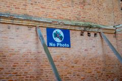 POKHARA, NEPAL - NOVEMBER 04, 2017: Informative sign of not allow photos in outdoors located close to a temple in. Pokhara, Nepal Royalty Free Stock Image