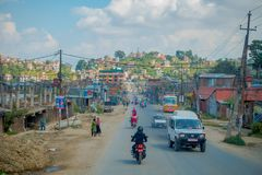 POKHARA, NEPAL OCTOBER 10, 2017: Outdoor view of asphalted road with some motorbikes, cars parked around in the street Royalty Free Stock Images