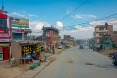 POKHARA, NEPAL OCTOBER 10, 2017: Outdoor view of asphalted road with some motorbikes, cars parked around in the street Royalty Free Stock Photography
