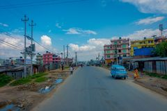 POKHARA, NEPAL OCTOBER 10, 2017: Outdoor view of asphalted road with some motorbikes, cars parked around in the street Royalty Free Stock Image