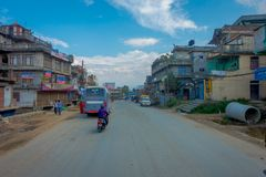 POKHARA, NEPAL OCTOBER 10, 2017: Outdoor view of asphalted road with some motorbikes, cars parked around in the street Stock Images