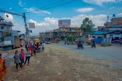 POKHARA, NEPAL OCTOBER 10, 2017: Outdoor view of asphalted road with some motorbikes, cars parked around in the street Stock Photos