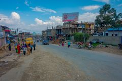 POKHARA, NEPAL OCTOBER 10, 2017: Outdoor view of asphalted road with some motorbikes, cars parked around in the street Royalty Free Stock Photo