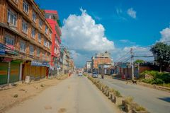 POKHARA, NEPAL OCTOBER 10, 2017: Outdoor view of asphalted road with some motorbikes, cars parked around in the street Royalty Free Stock Photos