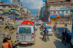 POKHARA, NEPAL OCTOBER 10, 2017: Outdoor view of asphalted road with traffict, some motorbikes, cars parked around in Royalty Free Stock Image
