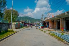 POKHARA, NEPAL - OCTOBER 06 2017: Outdoor view of different buildings with a pavement street, with some cables lines in. Pokhara, Nepal stock image