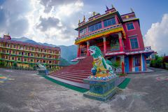 POKHARA, NEPAL - OCTOBER 06 2017: Tibet architecture. with a stoned lion at the enter of Sakya monastery is a pilgrim Royalty Free Stock Photo