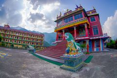 POKHARA, NEPAL - OCTOBER 06 2017: Tibet architecture. with a stoned lion at the enter of Sakya monastery is a pilgrim Stock Photos