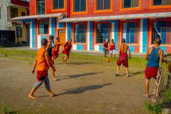 POKHARA, NEPAL - OCTOBER 06 2017: Unidentified Buddhist monk teenager playing soccer at the Sakya Tangyud monastery in. The Spiti valley in Pokhara, Nepal Stock Photos