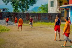 POKHARA, NEPAL - OCTOBER 06 2017: Unidentified Buddhist monk teenager playing soccer at the Sakya Tangyud monastery in Stock Photos