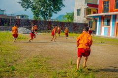 POKHARA, NEPAL - OCTOBER 06 2017: Unidentified Buddhist monk teenager playing soccer at the Sakya Tangyud monastery in. The Spiti valley in Pokhara, Nepal Royalty Free Stock Photo