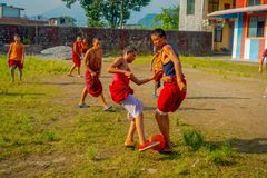 POKHARA, NEPAL - OCTOBER 06 2017: Unidentified Buddhist monk teenager playing soccer at the Sakya Tangyud monastery in. The Spiti valley in Pokhara, Nepal Royalty Free Stock Photography
