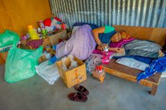 POKHARA, NEPAL - OCTOBER 06 2017: Unidentified old woman sleeping after a hard hay working on loom manufacturing wool Stock Images