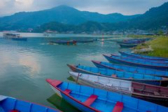 Pokhara, Nepal - September 04, 2017: Beautiful view of blue boats in the lake in Pokhara city , Nepal Royalty Free Stock Photos