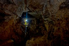 Pokhara, Nepal - September 12, 2017: Natural sun ligh entering from a small hole inside of the Bat Cave, in Nepali. Language, it is called Chameri Gufa. The Royalty Free Stock Images