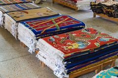 Shop with hand-woven carpets in Tashi Ling village. stock photos