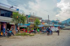 POKHARA, NEPAL, SEPTEMBER 04, 2017: Unidentified people walking at outdoors near of market shops in dowtown near the Stock Photography