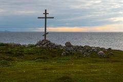 Poklonny cross by the sea on Bolshoy Zayatsky Island. Solovetsky archipelago, White sea, Russia stock photos