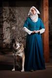 Magdalenka z psem Indoors Zdjęcie Stock