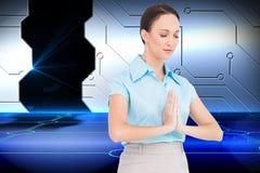 Pokojowy młody bizneswomanu modlenie Obrazy Stock
