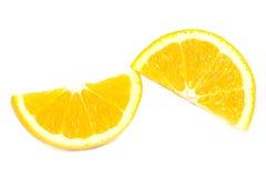 Pokrajać pomarańcze na białym tle Obrazy Stock