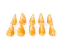 Pokrajać sekcje odizolowywać nad białym tłem tangerine Obrazy Stock