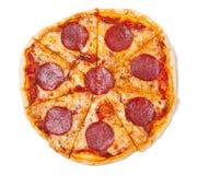 pokrajać pizza salami Zdjęcie Stock