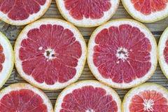 Pokrojone grapefruitowe, Owocowe tekstury, siekać, cytrus, cięcie, łasowanie, jedzenie, świeży, świeżość, owoc, obrazy royalty free