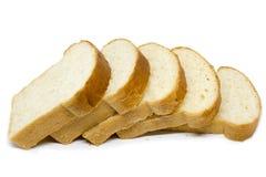 Pokrojonego chlebowego bochenka biały chleb na białym tle Obraz Royalty Free