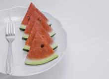 Pokrojony arbuz na talerzu, Zdjęcia Royalty Free