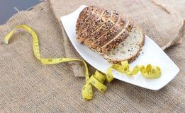 Pokrojony chleb i miara taśmy Obraz Royalty Free