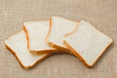 Pokrojony chleb na grabić Obrazy Royalty Free