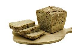 Pokrojony chleb na popiół desce Zdjęcia Stock