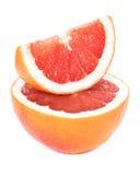 Pokrojony grapefruitowy na białym tle Fotografia Stock