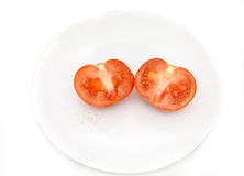 Pokrojony pomidor na talerzu Zdjęcia Royalty Free