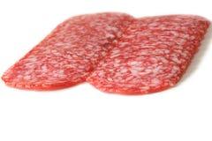 Pokrojony salami na bielu Zdjęcie Stock
