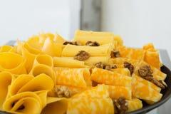 Pokrojony ser z orzechami włoskimi na talerzu Obrazy Royalty Free