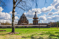 The Pokrovskaya church and the bellfry behind the birch tree at the Easter day. Stock Photography