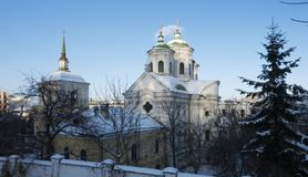 Pokrovskaya church in Kiev on the Podol. Built in 1772 by the architect IG Grigorovich-Barsky. Winter sunny day. Ancient orthodox church with green domes Royalty Free Stock Photo