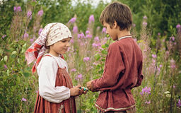 POKROVSKOE, SVERDLOVSK OBLAST, RUSSIA - JULY 17, 2016: Historical reenactment of Russian Civil war in the Urals in 1919. Children Royalty Free Stock Images