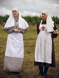 POKROVSKOE, SVERDLOVSK OBLAST, RUSSIA - JULY 17, 2016: Historical reenactment of Russian Civil war in the Urals in 1919. The sist. Ers of mercy Royalty Free Stock Images