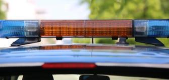 Polícia do carro com sirenes Fotos de Stock