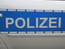 Polícia no azul e no silverwhite (Polizei) Alemanha fotografia de stock royalty free