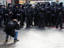 Polícia político do fotógrafo da ação Imagens de Stock