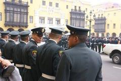 Polícia que olha uma parada Fotos de Stock Royalty Free