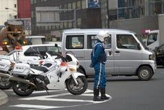 Polícia, Tóquio, Japão imagem de stock royalty free