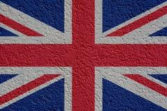 Política de Gran Bretaña o concepto del negocio: Pared BRITÁNICA de la bandera con el yeso, textura libre illustration