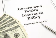 Política y efectivo del seguro médico del gobierno Imagen de archivo