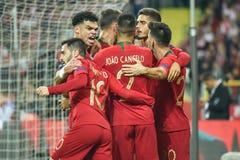 Polônia contra o 2:3 de Portugal Pepe L, Andre Silva R e jogadores de Portugal após ter marcado o objetivo fotografia de stock